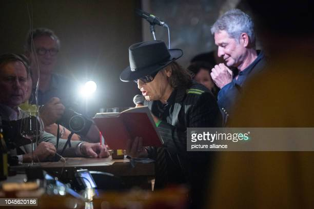 Udo Lindenberg singer and Thomas Hüetlin journalist and author read excerpts from the new biography Udo in the Berlin Bar Freundschaft Lindenberg and...