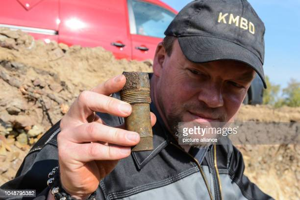 The explosives master Mike Schwitzke holds the detonator of the defused world war bomb in his hand A 250 kilogram world war bomb was defused in...