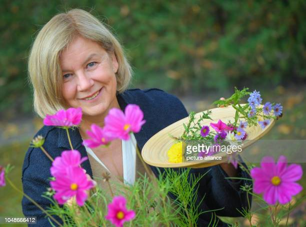 08 October 2018 Brandenburg Schoeneiche Martina GöldnerKabitzsch owner of the Blythen manufactory stands in her garden and picks flowers For many...