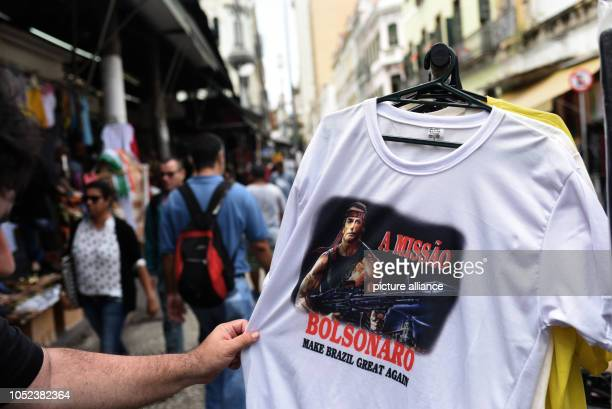 17 October 2018 Brazil Rio de Janeiro A Tshirt that shows Jair Bolsonaro as a fighter is sold in one of the biggest street markets in Rio de Janeiro...