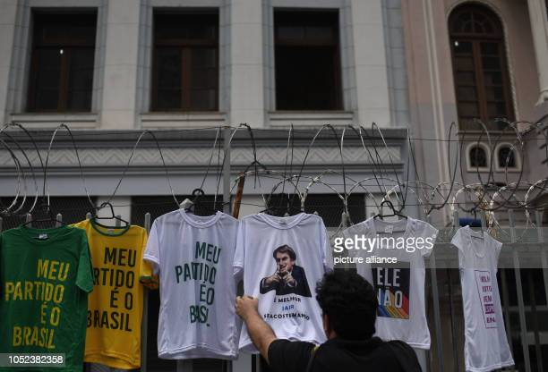 17 October 2018 Brazil Rio de JaneiroA man is looking at a Tshirt with a photo of Jair Bolsonaro sold at one of the largest street markets in Rio de...