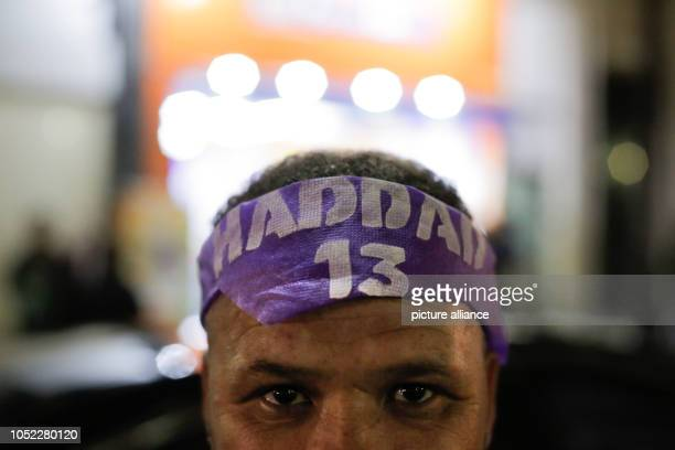 15 October 2018 Brazil Sao Paulo A man is wearing a scarf with the inscription 'Haddad' Two and a half weeks before the second ballot in Brazil...