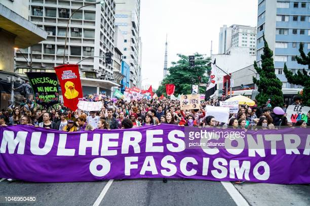 People holding a banner with the inscription Mulheres contra o fascismo during a demonstration against the extreme right presidential candidate...