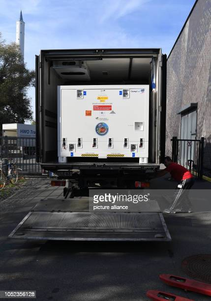 An employee of a transport company closes the loading ramp of the truck that loaded the research satellite EuCROPIS The DLR satellite is to orbit the...
