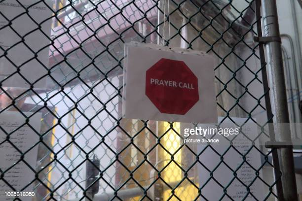 A sign with the inscription 'Prayer Call' hangs on a fence The infamous camp has now existed for almost 17 years 40 inmates are still being held...