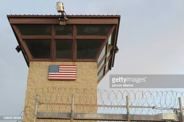 A watchtower stands behind a barbed wire fence The infamous camp has now existed for almost 17 years 40 inmates are still being held there Photo...