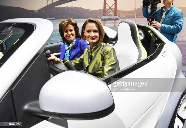 01 October 2018 France Paris The new smart boss Karin Adt sits in a Smart forease during a MercedesBenz Media Preview in Paris Next to her is Anette...
