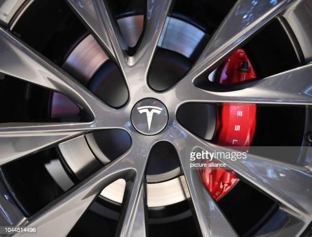 October 2018, France, Paris: 02 October 2018, France, Paris: A Tesla logo taken on a rim of a Tesla Model S at the Paris International Motor Show on...