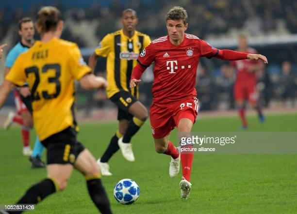 Soccer Champions League AEK Athens Bayern Munich Group stage Group E Matchday 3 Thomas Müller from FC Bayern Munich fights with Niklas Hult and...