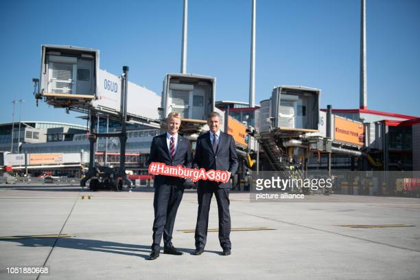 Michael Eggenschwiler CEO of Hamburg Airport and Volker Greiner Emirates Vice President for Northern and Central Europe are standing in front of...
