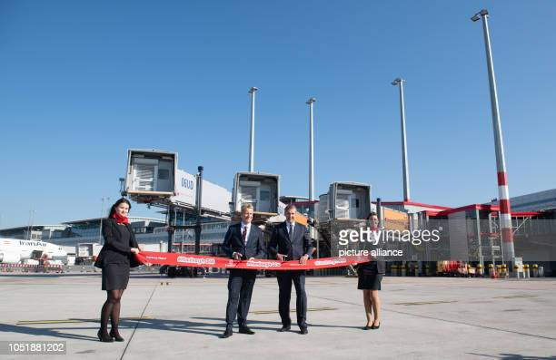 Michael Eggenschwiler CEO of Hamburg Airport and Volker Greiner Emirates Vice President for Northern and Central Europe cut a red ribbon in front of...