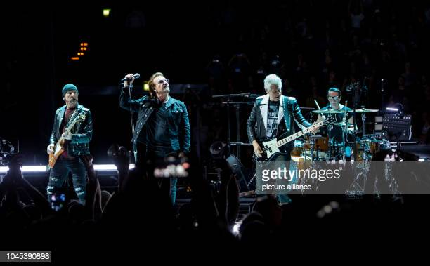 The band U2 with David Howell Evans guitarist Paul David Hewson vocalist Adam Clayton bassist and Larry Mullen junior drummer performs during their...
