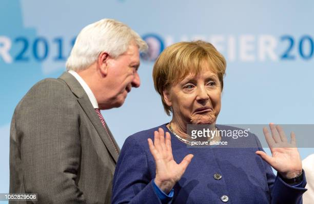 After her speech Chancellor Angela Merkel is now pulling out her face next to Hesse's Prime Minister Volker Bouffier A new state parliament will be...