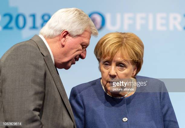 Chancellor Angela Merkel and Hesse's Prime Minister Volker Bouffier talk on stage A new state parliament will be elected in Hesse on Photo Silas...