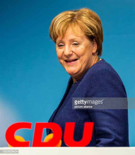 Chancellor Angela Merkel passes a CDU logo in the Römerhalle A new state parliament will be elected in Hesse on Photo Silas Stein/dpa