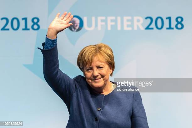 Chancellor Angela Merkel waves from the stage in the Römerhalle A new state parliament will be elected in Hesse on Photo Silas Stein/dpa