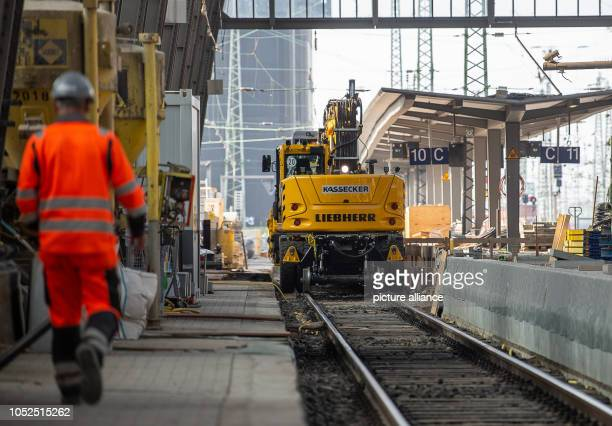A worker walks along the construction site during extensive modernization and renovation work on platforms 10 and 11 in Frankfurt Central Station...