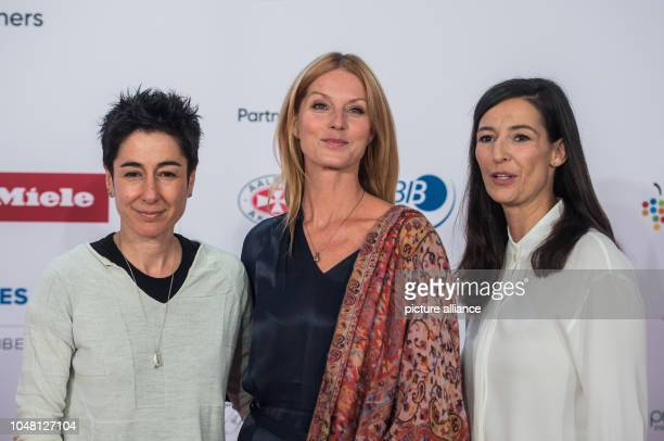 Dunja Hayali TV presenter Esther Schweins actress and Pinar Atalay TV presenter stand on the red carpet The Frankfurt Book Fair is the largest book...