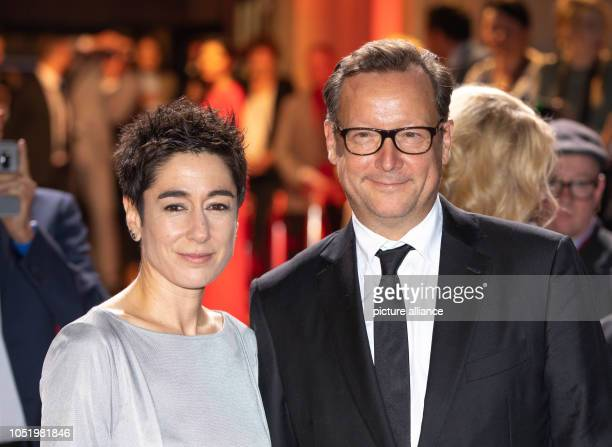 12 October 2018 Germany Frankfurt am Main Moderator Dunja Hayali and actor Matthias Brandt arrive at the Alte Oper to receive the 29th Hessian Film...