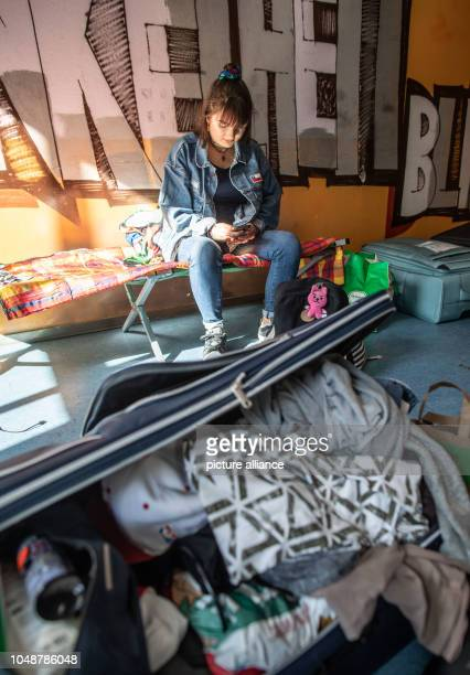 Celina Ufken who is currently beginning her medical studies at Frankfurt's Johann Wofgang Goethe University is sitting on a camp bed in the student...