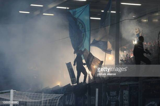 Soccer DFB Cup SV Wehen Wiesbaden Hamburger SV 2nd round in the Brita Arena Fans of HSV ignite pyrotechnics in their block Photo Thomas Frey/dpa...