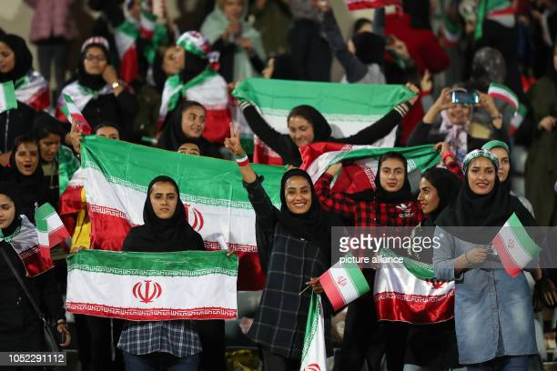 16 October 2018 Iran Tehran Soccer International matches Iran Bolivia in Tehran Iran Iranian women waving national flags in the stands during the...