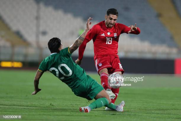 Iran's Alireza Jahanbakhsh and Bolivia's Rudy Cardozo battle for the ball during an International Friendly soccer match between Iran and Bolivia at...