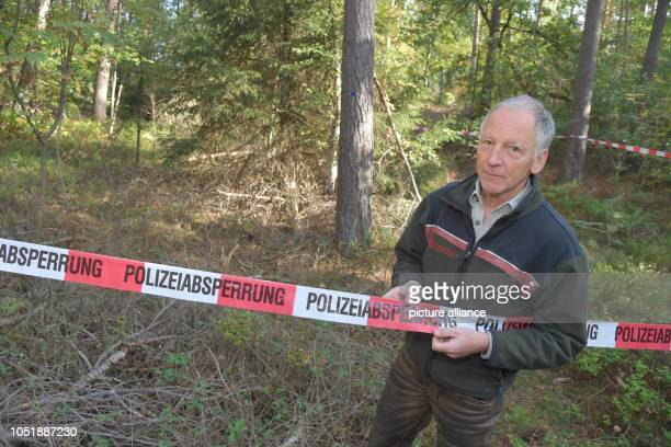 10 October 2018 Lower Saxony Neu Sülbeck The forester Oliver Christmann is standing at a police barricade Christman had found a human skull Now...