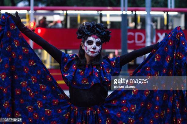 A disguised woman takes part in the celebrations of the Day of the Dead The Dia de los Muertos is one of the most important celebrations in Mexico in...