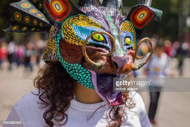 A woman wearing a mask at the annual parade in the historic center of Mexico City Photo Gerardo Vieyra/dpa