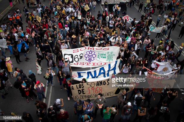 Demonstrators take part in a march in memory of the victims of a student massacre Tens of thousands of people commemorated the victims of the student...