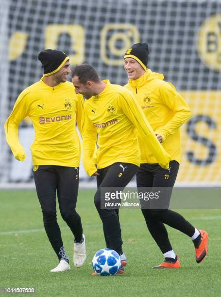 02 October 2018 North RhineWestphalia Dortmund 02 October 2018 Germany Dortmund Achraf Hakimi Paco Alcácer and Marco Reus from Borussia Dortmund take...