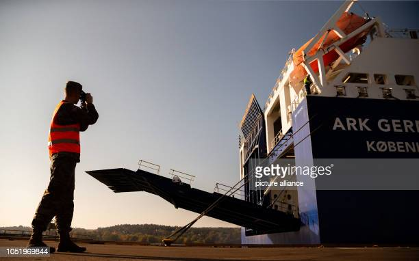 11 October 2018 Norway Fredrikstad A soldier photographed while the loading ramp of the RoRo ship 'ARK GERMANIA' is opened at the harbour of...