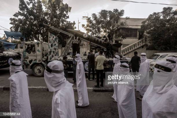 05 October 2018 Palestinian Territories Gaza City Members of AlQuds Brigades the military wing of the Palestinian Islamic Jihad movement march during...