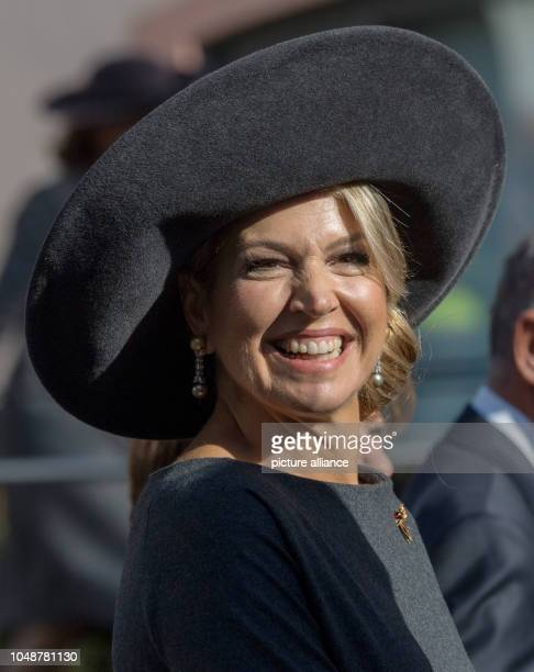 10 October 2018 RhinelandPalatinate Mainz Queen Maxima of the Netherlands laughs when she arrives at the State Chancellery The royal couple are in...