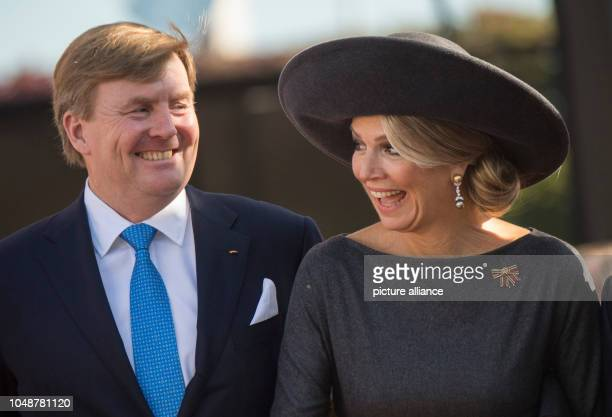 10 October 2018 RhinelandPalatinate Mainz WillemAlexander King of the Netherlands and Queen Maxima arrive at the State Chancellery in Mainz According...