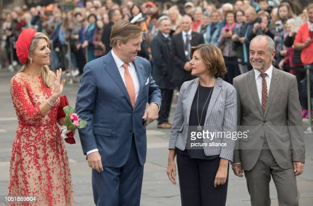 11 October 2018 RhinelandPalatinate Trier Queen Maxima and King WillemAlexander of the Netherlands arrive at the Porta Nigra with Malu Dreyer Prime...