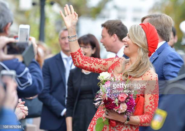 11 October 2018 RhinelandPalatinate Trier Queen Maxima and WillemAlexander King of the Netherlands welcome spectators in front of the State...