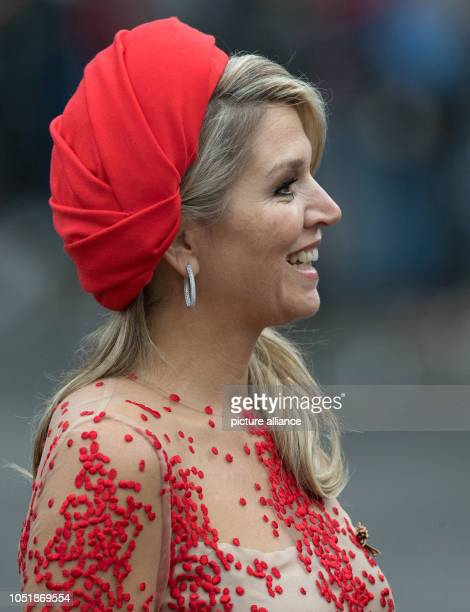 11 October 2018 RhinelandPalatinate Trier Queen Maxima of the Netherlands smiles at her arrival at the Porta Nigra The royal couple are visiting...
