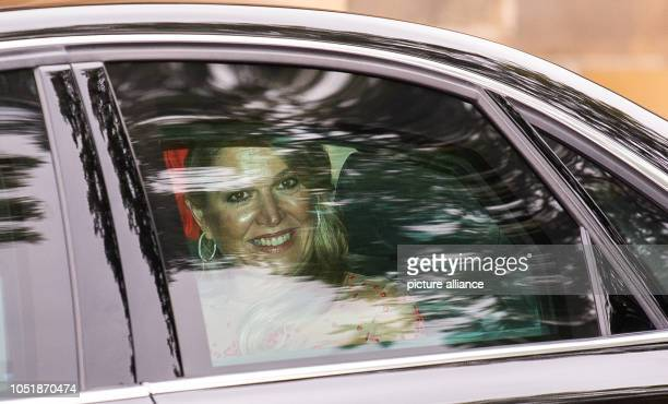 11 October 2018 RhinelandPalatinate Trier Queen Maxima smiles in her vehicle at her right of way on the Domfreihof The Dutch royal couple are...