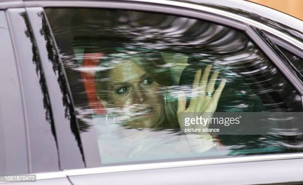 11 October 2018 RhinelandPalatinate Trier Queen Maxima waves to the onlookers in her vehicle on her way to the cathedral courtyard The Dutch royal...