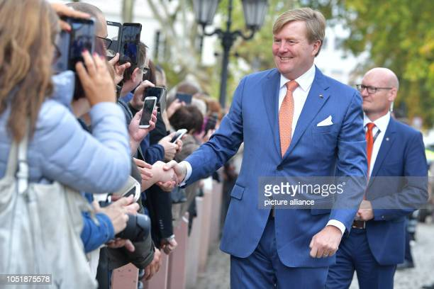 WillemAlexander King of the Netherlands welcomes spectators in front of the State Chancellery The royal couple are visiting Germany for several days...