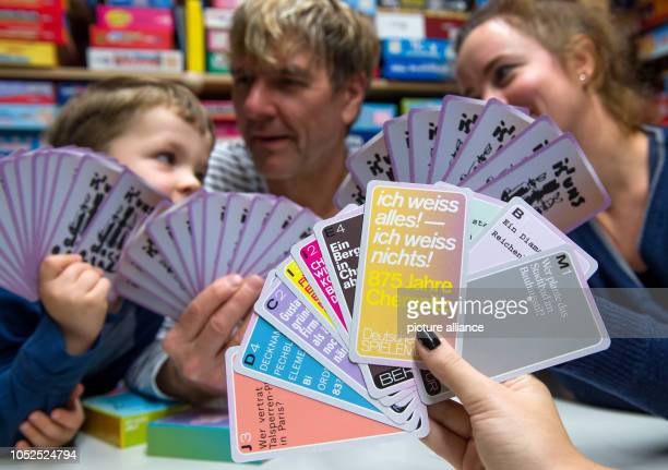 19 October 2018 Germany Chemnitz A family plays the card game 'Ich weiss alles' in the German Games Museum in Cemnitz I don't know anything 875 years...