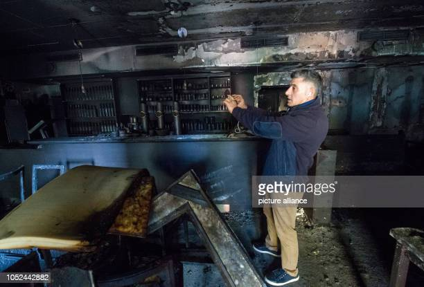 Ali Tulasoglu photographs the charred rooms of his Turkish restaurant in Chemnitz Unknown men had set fire to the restaurant that night State...