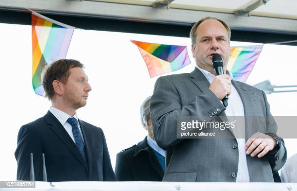 First Mayor of Dresden Dirk Hilbert addressing Saxony's Prime Minister Michael Kretschmer on a car of the demonstration Heart instead of agitation On...