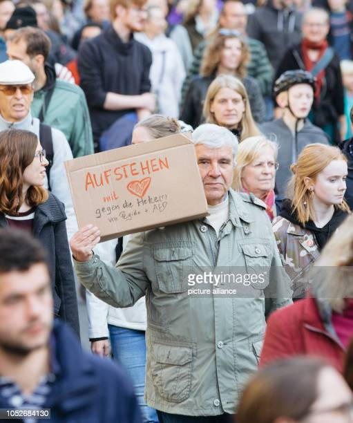 Participants in the demonstration Heart instead of agitation walking through Dresden's city centre to stand up for cosmopolitanism on the fourth...