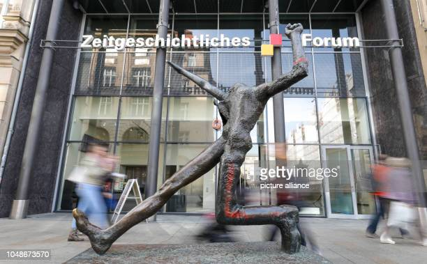 Bronze sculpture 'Der Jahrhundertschritt' by Mattheuer 1984 stands in front of the Zeitgeschichtliches Forum Leipzig The Contemporary History Forum...