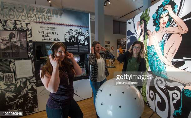 Participants of a preview of the exhibition 'Oh Yeah Pop music in Germany' listen to music examples in the show at the Stadtgeschichtliches Museum...