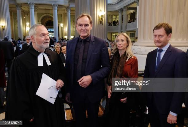The theologian and former civil rights activist Markus Meckel Leipzig's Lord Mayor Burkhard Jung his wife Ayleena Jung and Saxony's Prime Minister...
