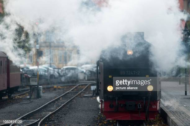 23 October 2018 SaxonyAnhalt Brockengipfel A train of the Harzer Schmalspurbahnen pushes wagons backwards out of the station Wernigerode after the...
